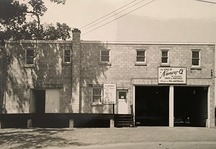 August 1956 -- The current wholesale produce warehouse at 662 Montreal Street, before we expanded and built the grocery store onto the building at the right-hand side in the photo.